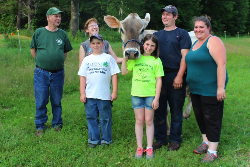 The Smith family of More Acres Farm in East Dixfield with the herd favorite and eldest milk cow - a Brown Swiss named Revlon. Pictured from left are Les, Judy, MJ, Amber, Matt and Stephanie.