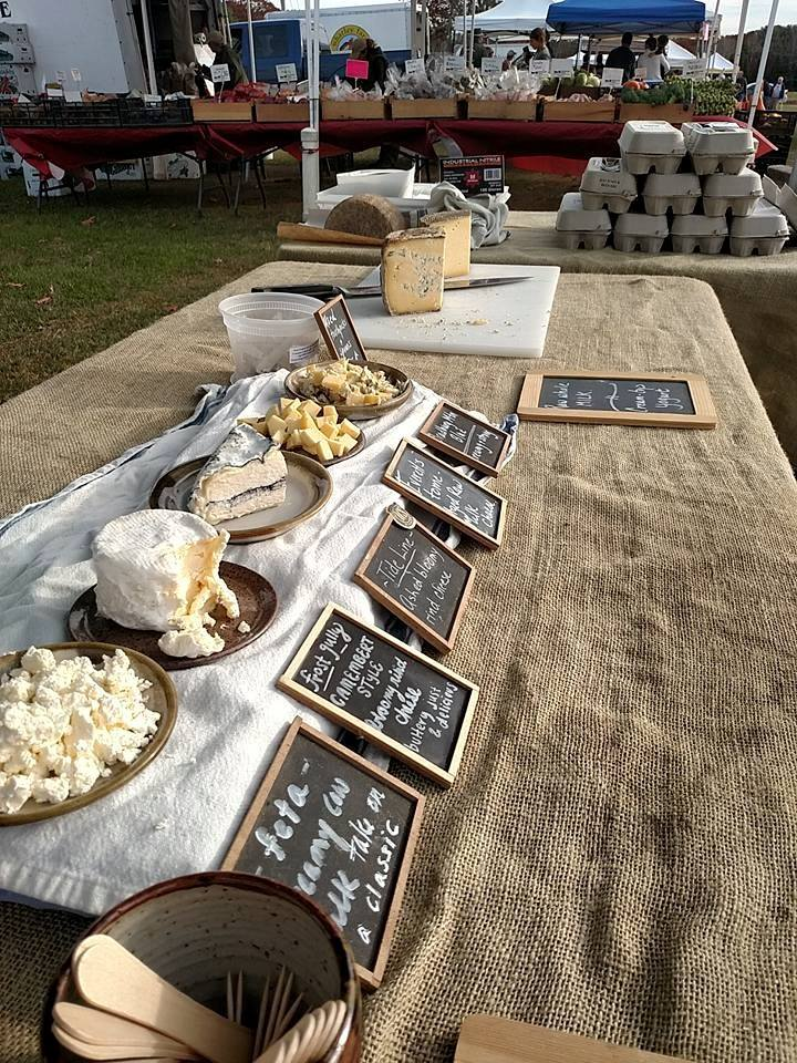 Some of Winter Hill's lineup of cheeses at a farmer's market. Photo from Winter Hill Farm Facebook page.
